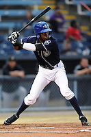 Asheville Tourists shortstop Rosell Herrera #7 swings at a pitch during a game suspended by rain against the West Virginia Power at McCormick Field on April 11, 2013 in Asheville, North Carolina. The Power eventually won 11-4. (Tony Farlow/Four Seam Images).