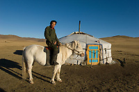 Nomad man with his horse and yurt