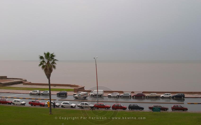 A view over the Rio de la Plata in Montevideo on a rainy day. Cars parked along the shore walk Rambla sur and Rambla Gran Bretagna along the River Rio de la Plata Montevideo, Uruguay, South America