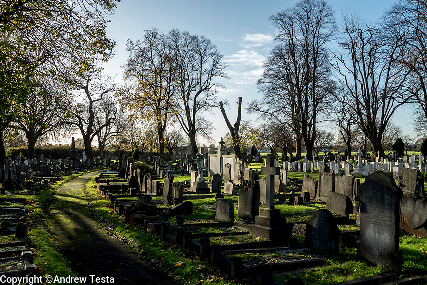 UK. London. 4th December 2015<br /> Edmonton Cemetery, where some of the stolen goods were buried under the grave of a relative of one of the robbers.<br /> Andrew Testa for the New York Times