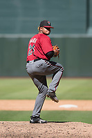Arizona Diamondbacks relief pitcher Junior Garcia (24) delivers a pitch to the plate during an Instructional League game against the Kansas City Royals at Chase Field on October 14, 2017 in Phoenix, Arizona. (Zachary Lucy/Four Seam Images)