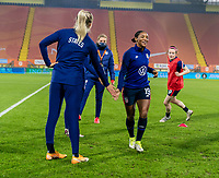 BREDA, NETHERLANDS - NOVEMBER 27: Samantha Mewis #3 of the USWNT warms up with Crystal Dunn #19 before a game between Netherlands and USWNT at Rat Verlegh Stadion on November 27, 2020 in Breda, Netherlands.