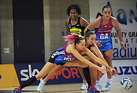 Steel's George Fisher (left) and Pulse's Kelly Jury stretch for the ball during the ANZ Premiership netball match between Central Pulse and Southern Steel at Te Rauparaha Arena in Porirua, New Zealand on Sunday, 16 May 2021. Photo: Dave Lintott / lintottphoto.co.nz