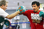 """April 4, 2011, Hollywood,Ca. ---  Superstar Manny Pacquiao(R) hits the mitts with his chief trainer Freddie Roach(L at the Wildcard Boxing Club in Hollywood Monday in preparation for his upcoming World Welterweight mega fight against """"Sugar"""" Shane Mosley on Saturday, May 7 at the MGM Grand in Las Vegas.  Pacquiao vs Mosley is promoted by Top Rank in association with MP Promotions,Sugar Shane Mosley Promotions,Tecate and MGM Grand.  The Pacquiao vs Mosley telecast will be available live on SHOWTIME Pay Per View.  --- Photo Credit : Chris Farina - Top Rank  (no other credit allowed)  copyright 2011"""