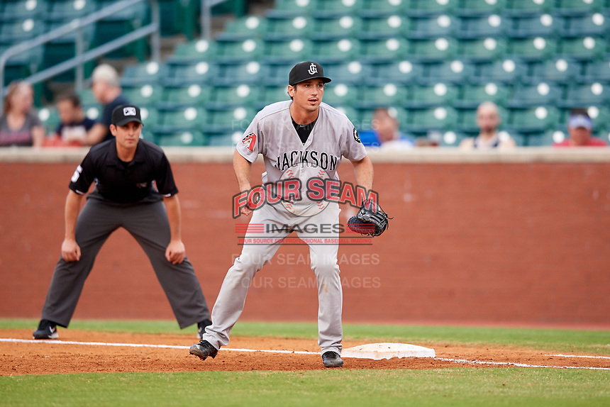 Jackson Generals first baseman Josh Prince (8) in front of first base umpire Anthony Perez during a game against the Chattanooga Lookouts on May 9, 2018 at AT&T Field in Chattanooga, Tennessee.  Chattanooga defeated Jackson 4-2.  (Mike Janes/Four Seam Images)