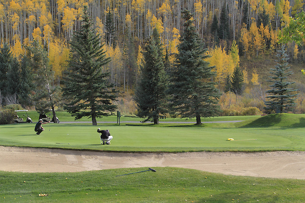 Men putting at the Vail Golf Course, Vail Colorado, USA.