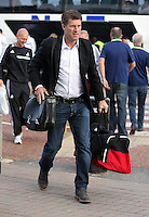 Wednesday 18 September 2013<br /> Pictured: Manager Michael Laudrup at Cardiff Airport.<br /> Re: Swansea City FC players and staff travelling to Spain for their UEFA Europa League game against Valencia.