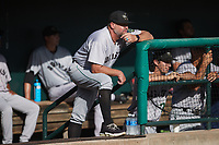 Augusta GreenJackets hitting coach Mike Bard (28) looks on from the top step of the dugout during the game against the Charleston Boiled Peanuts at Joseph P. Riley, Jr. Park on June 26, 2021 in Charleston, South Carolina. (Brian Westerholt/Four Seam Images)