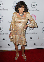 BEVERLY HILLS, CA, USA - OCTOBER 11: Joan Collins arrives at the 2014 Carousel Of Hope Ball held at the Beverly Hilton Hotel on October 11, 2014 in Beverly Hills, California, United States. (Photo by Celebrity Monitor)