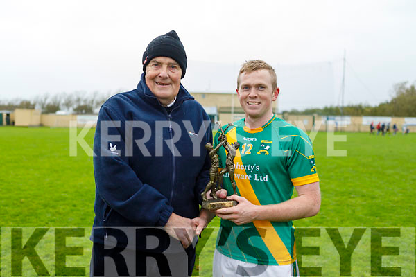 Kilmoyley Daniel Collins receives the MOTM award in the North Kerry Senior Hurling Championship final from Joe Walsh of the NKHB.