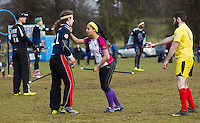 08 MAR 2015 - NOTTINGHAM, GBR - Francesca Kempster (centre), the Loughborough Longshots seeker attempts to keep Radcliffe Chimeras seeker David Goswell (left) from snitch runner Jordan Niblock (right) to allow her team a chance of closing the score gap to within the 30 points value of the snitch during their 2015 British Quidditch Cup semi final at Woollaton Hall and Deer Park in Nottingham, Great Britain (PHOTO COPYRIGHT © 2015 NIGEL FARROW, ALL RIGHTS RESERVED)