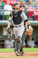 Indianapolis Indians catcher Ryan Doumit #12 watches the flight of a fly ball during the game against the Charlotte Knights at Knights Stadium on July 26, 2011 in Fort Mill, South Carolina.  The Knights defeated the Indians 5-4.   (Brian Westerholt / Four Seam Images)