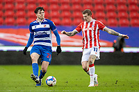 6th February 2021; Bet365 Stadium, Stoke, Staffordshire, England; English Football League Championship Football, Stoke City versus Reading; Tom Holmes of Reading crosses the ball in front of James McClean of Stoke City