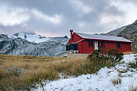 Dawn over Brewster Hut with Mt. Brewster behind, Mt. Aspiring National Park, UNESCO World Heritage Area, New Zealand, NZ