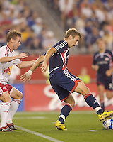 The Revolution's (20) Taylor Twellman  dribbles as Red Bulls (33) Chris Leitch defends. New England Revolution defeated the New York Red Bulls, 2-1,  at Gillette Stadium, Foxborough, MA on August 25, 2007.