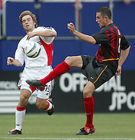 17 April 2004: DC United Bobby Convey tries to block MetroStars Mark Lisi's ball at Giants' Stadium in East Rutherford, New Jersey.  MetroStars defeated DC United, 3-2.