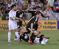 AC Milan forward Ronaldinho (80) gets taking down by DC United defender Barry Rice (15)   DC United midfielder Kurt Morsink (6) and DC United midfielder Devon Mctavish (18). DC United defeated AC. Milan 3-2 at RFK Stadium, Wednesday May 26, 2010.