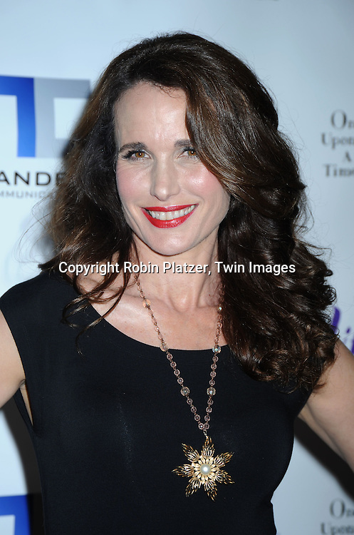"""actress Andie MacDowell in Donna Karan outfit posing for photographers at The Lifetime Television screening of Patricia Cornwell's novel """"The Front"""" starring Daniel Sunjata, Andie MacDowell and Ashley Williams at The Hearst Tower on April 7, 2010."""