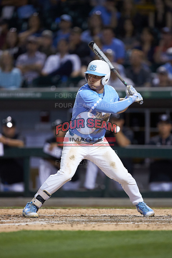 Michael Busch (15) of the North Carolina Tar Heels at bat against the South Carolina Gamecocks at BB&T BallPark on April 3, 2018 in Charlotte, North Carolina. The Tar Heels defeated the Gamecocks 11-3. (Brian Westerholt/Four Seam Images)