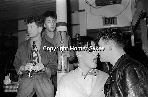 Covent Garden, London. 1980 <br /> Just friends and onlookers at the Blitz Club.<br /> <br /> Ollie O'Donnell founder of the Wag Club. <br /> Perry Haines at back.<br /> In foreground Christos Tolera (would become singer in band Blue Rondo A La Turk and a portrait painter who is based in London.) and Barry (The Rat) Bryan<br /> <br /> Names thanks to Christos Tolera
