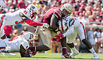 Florida State running back Jacquez Patrick grimaces as he's hit by North Carolina State's Shawn Boon, right, and Jarius Morehead (31) and Jerod Fernandez (4) in the second half of an NCAA college football game in Tallahassee, Fla., Saturday, Sept. 23, 2017.  NC State defeated Florida State 27-21. (AP Photo/Mark Wallheiser)