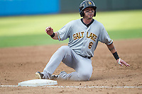 Salt Lake Bees first baseman Luis Rodriguez (6) slides into third base during the Pacific Coast League baseball game against the Round Rock Express on August 10, 2013 at the Dell Diamond in Round Rock, Texas. Round Rock defeated Salt Lake 9-6. (Andrew Woolley/Four Seam Images)