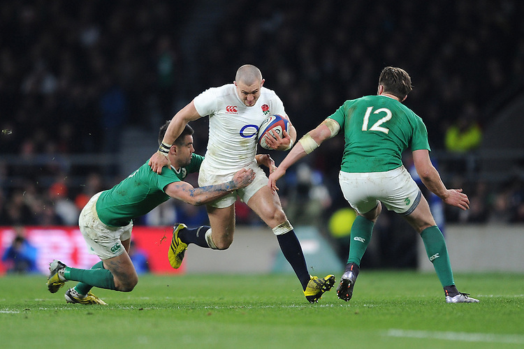 Mike Brown, FEBRUARY 27, 2016 - Rugby : Mike Brown of England is tackled by Conor Murray and Jack McGrath of Ireland during the RBS 6 Nations match between England and Ireland at Twickenham Stadium, London, United Kingdom. (Photo by Rob Munro)