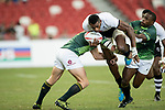 Ruhan Nel (left) and Siviwe Soyizwapi (right) of South Africa try to stop Sevuloni Mocenacagi of Fiji who runs with the ball during the match Fiji vs South Africa, Day 2 of the HSBC Singapore Rugby Sevens as part of the World Rugby HSBC World Rugby Sevens Series 2016-17 at the National Stadium on 16 April 2017 in Singapore. Photo by Victor Fraile / Power Sport Images