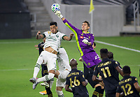 LOS ANGELES, CA - SEPTEMBER 13: Pablo Sisniega #23 GK of LAFC punches away a ball from Felipe Mora #9 of the Portland Timbers during a game between Portland Timbers and Los Angeles FC at Banc of California stadium on September 13, 2020 in Los Angeles, California.