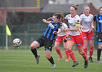 Jody Vangheluwe (22) of Club Brugge and Pauline Windels (5) of Zulte-Waregem pictured during a female soccer game between SV Zulte - Waregem and Club Brugge YLA on the 13 th matchday of the 2020 - 2021 season of Belgian Scooore Womens Super League , saturday 6 th of February 2021  in Zulte , Belgium . PHOTO SPORTPIX.BE   SPP   DIRK VUYLSTEKE