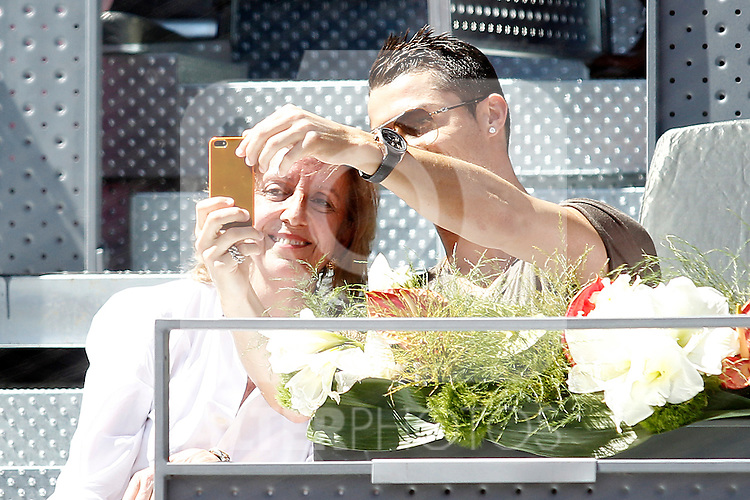 Real Madrid's Cristiano Ronaldo with a fan during Madrid Open Tennis 2015 match.May, 7, 2015.(ALTERPHOTOS/Acero)