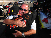 Apr. 13, 2008; Las Vegas, NV, USA: NHRA top fuel dragster driver Cory McClenathan is congratulated by team owner Don Schumacher (right) after winning the SummitRacing.com Nationals at The Strip in Las Vegas. Mandatory Credit: Mark J. Rebilas-