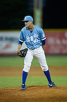 Burlington Royals relief pitcher Mark McCoy (41) looks to his catcher for the sign against the Danville Braves at Burlington Athletic Park on August 13, 2015 in Burlington, North Carolina.  The Braves defeated the Royals 6-3. (Brian Westerholt/Four Seam Images)