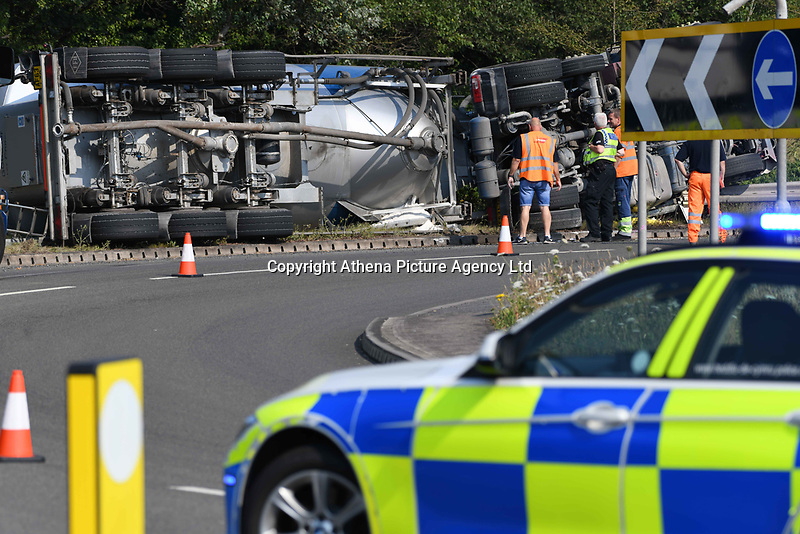 Pictured is a tanker overturned near the entrance to Tata Steel Works in Port Talbot, South Wales, UK. The vehicle left the road and toppled over the road barrier, leaving it stranded and the road closed. Tuesday16 July 2019