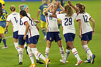 ORLANDO, FL - JANUARY 22: Catarina Macario #29 celebrates her goal with Megan Rapinoe #15 and teammates after scoring the first goal of the game during a game between Colombia and USWNT at Exploria stadium on January 22, 2021 in Orlando, Florida.