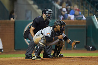 West Virginia Power catcher Rafelin Lorenzo (37) sets a target as home plate umpire Thomas Fornarola looks on during the game against the Greensboro Grasshoppers at First National Bank Field on August 9, 2018 in Greensboro, North Carolina. The Power defeated the Grasshoppers 9-7 in game two of a double-header. (Brian Westerholt/Four Seam Images)