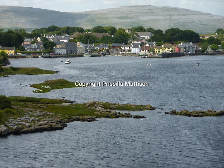 Kinvara, Republic of Ireland - July 17, 2010:  Multi-colored buildings look onto the head of Kinvara Bay.