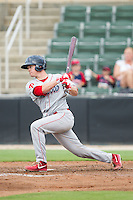 Andrew Knapp (16) of the Lakewood BlueClaws follows through on his swing against the Kannapolis Intimidators at CMC-NorthEast Stadium on July 20, 2014 in Kannapolis, North Carolina.  The Intimidators defeated the BlueClaws 7-6. (Brian Westerholt/Four Seam Images)
