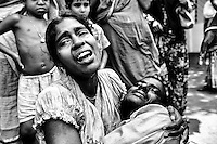 Bobita's sister and brother crying for Bobita. Bobita found dead after the 16th days of building collapse. Savar, near Dhaka, Bangladesh