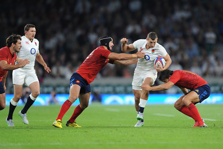 Jonny May of England is tackled by Alexandre Dumoulin and Francois Trinh-Duc of France - 15/08/2015 - Twickenham Stadium - London <br /> Mandatory Credit: Rob Munro/Stewart Communications