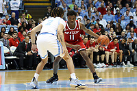 CHAPEL HILL, NC - FEBRUARY 25: Markell Johnson #11 of North Carolina State University is defended by Cole Anthony #2 of the University of North Carolina during a game between NC State and North Carolina at Dean E. Smith Center on February 25, 2020 in Chapel Hill, North Carolina.