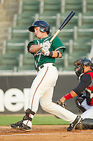 Justin Bass #14 of the Greensboro Grasshoppers follows through on his swing against the Kannapolis Intimidators at Fieldcrest Cannon Stadium August 2, 2010, in Kannapolis, North Carolina.  Photo by Brian Westerholt / Four Seam Images