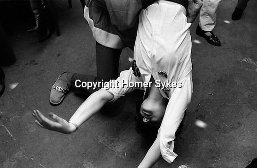 Blitz Club Covent Garden London 1980. UK.<br /> Luciana Martinez hanging around upside dancing.