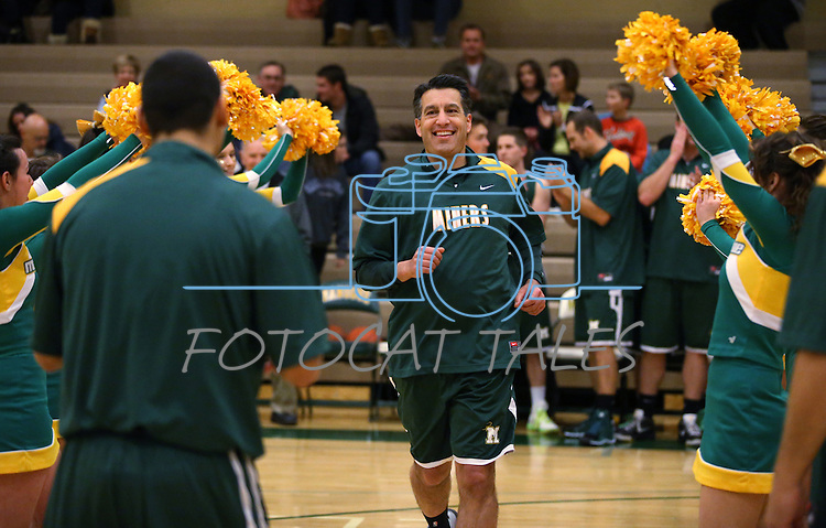 Nevada Gov. Brian Sandoval gets introduced in an alumni basketball game during the Wild West Shootout at Bishop Manogue High School in Reno, Nev., on Wednesday, Dec. 4, 2013. The Miners defeated the alumni 79-62 in the fundraiser for Sierra Kids Foundation, an autism organization. <br /> Photo by Cathleen Allison
