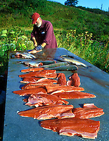 Fisherman filleting Sockeye Salmon. Kalgin Island, Alaska