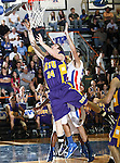 Hardin-Simmons Cowboys forward Dustin Massey (24) goes in for a layup in the game between the UTA Mavericks and the Hardin-Simmons Cowboys held at the University of Texas in Arlington's Texas Hall in Arlington, Texas. UTA defeats Hardin-Simmons 88 to 71.