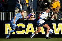 Notre Dame Fighting Irish forward Melissa Henderson (6) is chased by North Carolina Tar Heels midfielder Ali Hawkins (76). The North Carolina Tar Heels defeated the Notre Dame Fighting Irish 2-1 during the finals of the NCAA Women's College Cup at Wakemed Soccer Park in Cary, NC, on December 7, 2008. Photo by Howard C. Smith/isiphotos.com