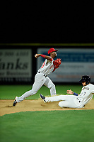 Vancouver Canadians shortstop Luis De Los Santos (20) attempts to turn a double play over Mason House (7) during a Northwest League game against the Tri-City Dust Devils at Gesa Stadium on August 21, 2019 in Pasco, Washington. Vancouver defeated Tri-City 1-0. (Zachary Lucy/Four Seam Images)