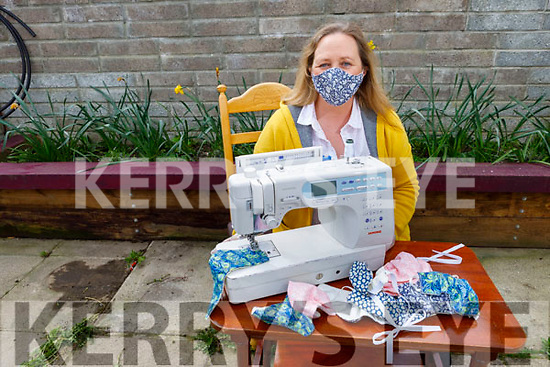 Georgina Maher displays her face masks which she is making at home on Monday.