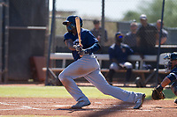 Milwaukee Brewers outfielder Demi Orimoloye (52) follows through on his swing during an Instructional League game against the San Diego Padres on September 27, 2017 at Peoria Sports Complex in Peoria, Arizona. (Zachary Lucy/Four Seam Images)